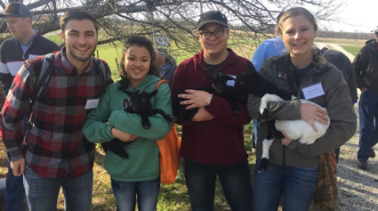 IASA members pose with cuddly small animals