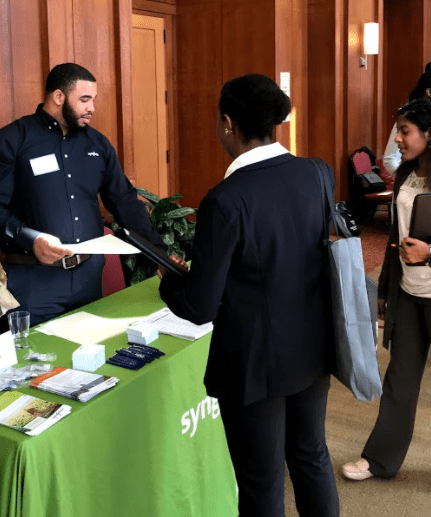 Student Engaging with Employer at Herbert College career fair